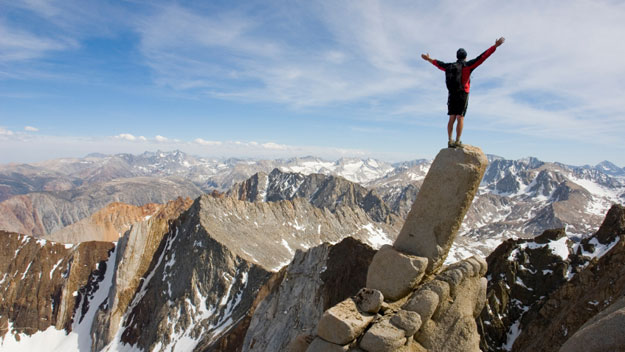 man-standing-on-edge-of-cliff
