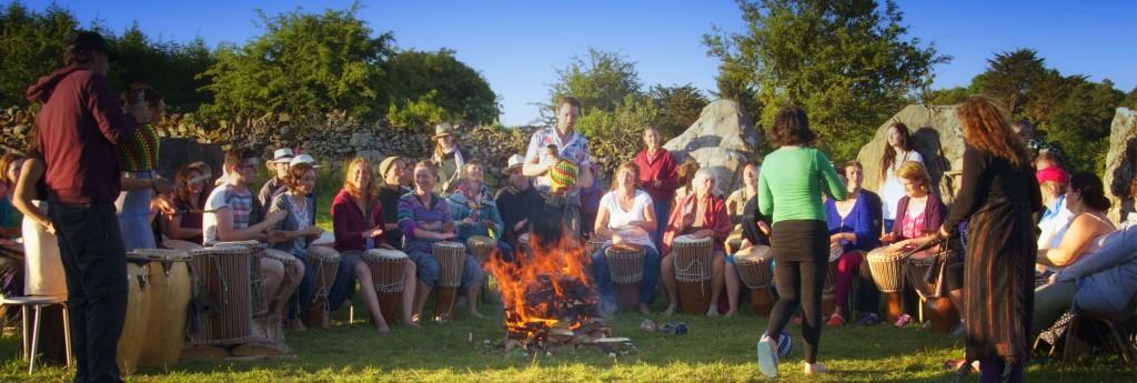 Tribal Spirit drumming in the stone circle at Earthsong Midsummer camp jpg