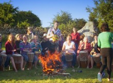 Tribal Spirit drumming in the stone circle at Earthsong Midsummer camp jpg