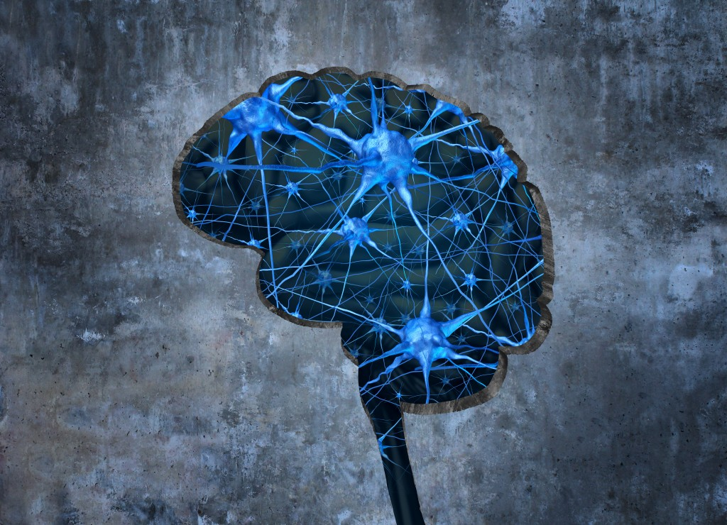 Inside human neurology research concept examining the mind of a human to heal memory loss or cells due to dementia and other neurological diseases as a hole shaped as a brain in a cement wall with neurons.