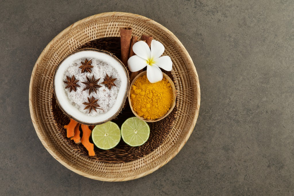 Asian spa setting with coconut, turmeric, lime, cinnamon, anise