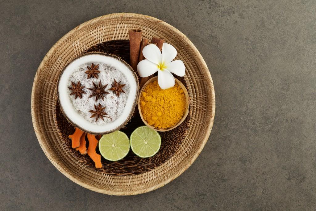 Asian spa setting with coconut, turmeric, lime, cinnamon, anise