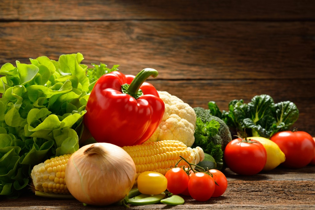 Vegetables isolated on wooden background