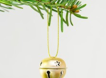 Decorative jingle bell ornament in a Christmas tree