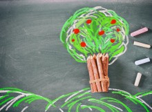 top view image of wooden pencils and tree drawing
