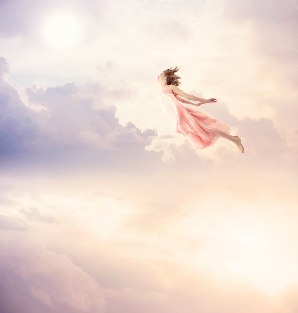 Girl in a pink dress flying through the sky
