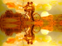Silhouette of two people Young couple sitting  one bicycle