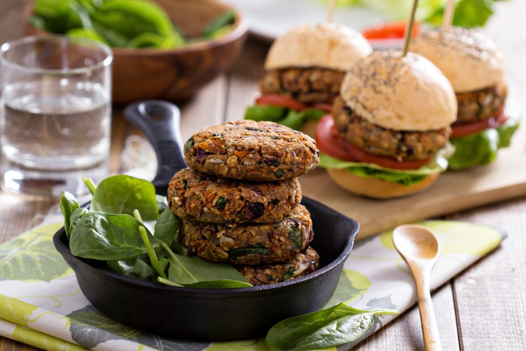 Vegan burgers with  beans and vegetables served with spinach